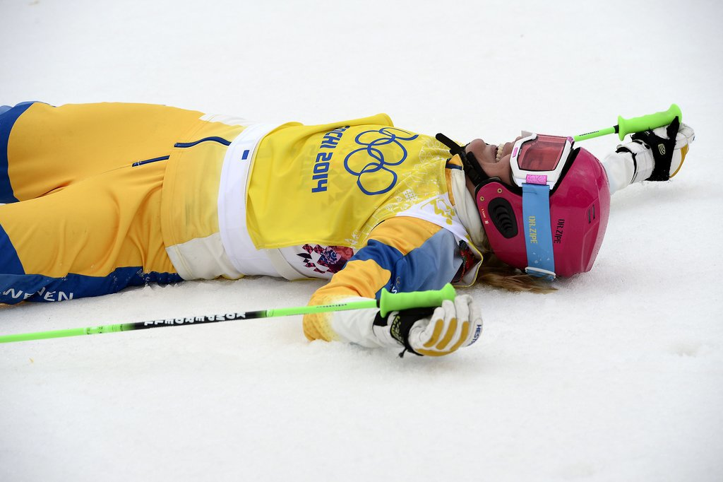 Bronze medallist Anna Holmlund of Sweden celebrated at the women's freestyle skiing ski cross finals.
