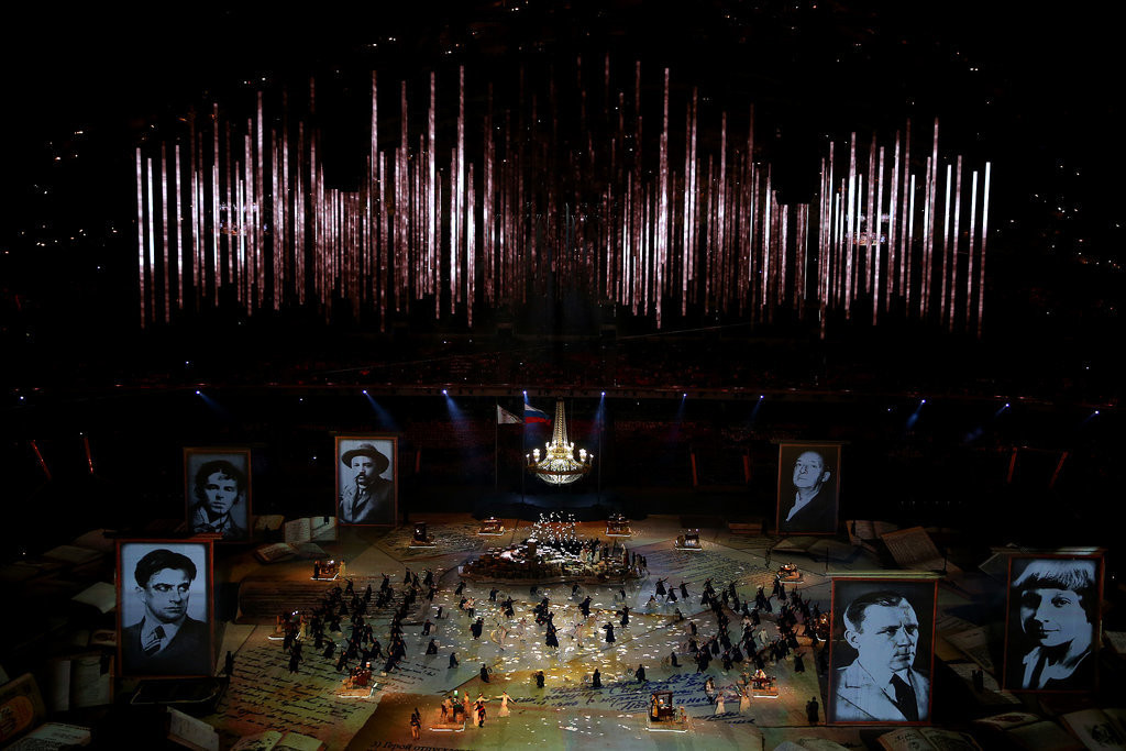 The performers paid tribute to Russian literature with giant portraits of authors.