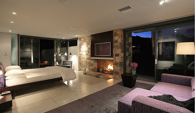 The master bedroom includes a fireplace and, of course, views of the San Jacinto Mountains.  Source: Capitas Real Estate