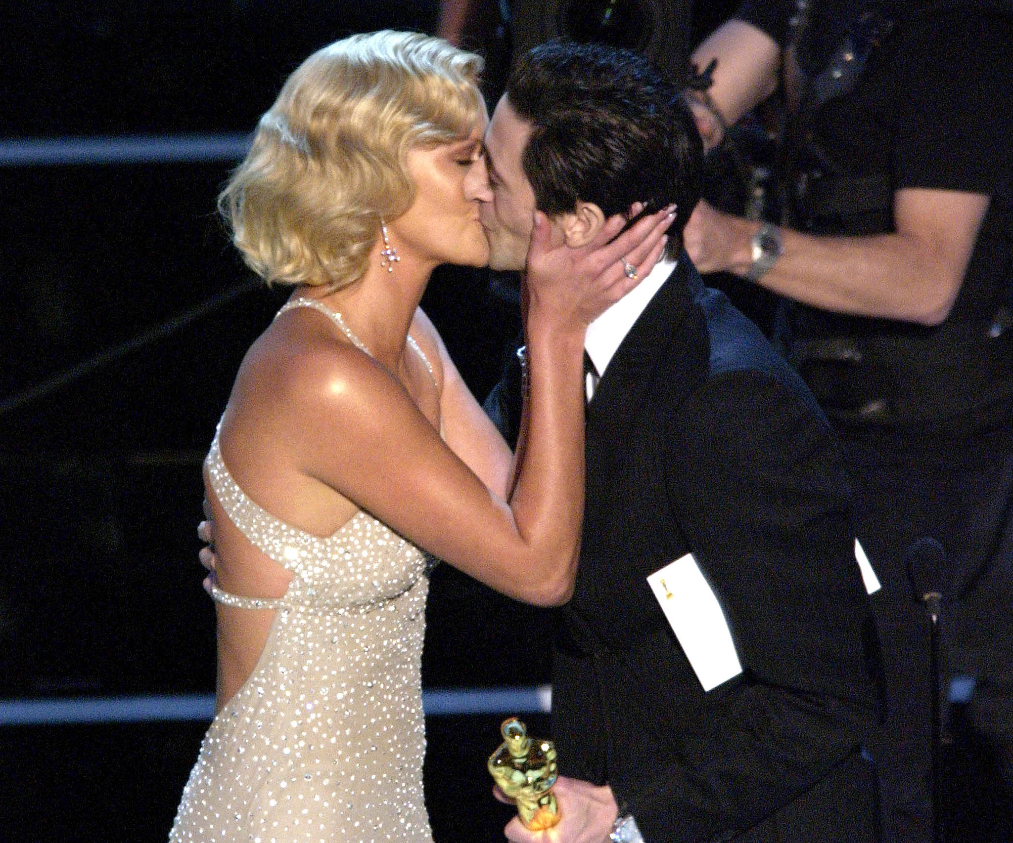 Charlize Theron planted a big kiss on Adrien Brody at the 2004 show.
