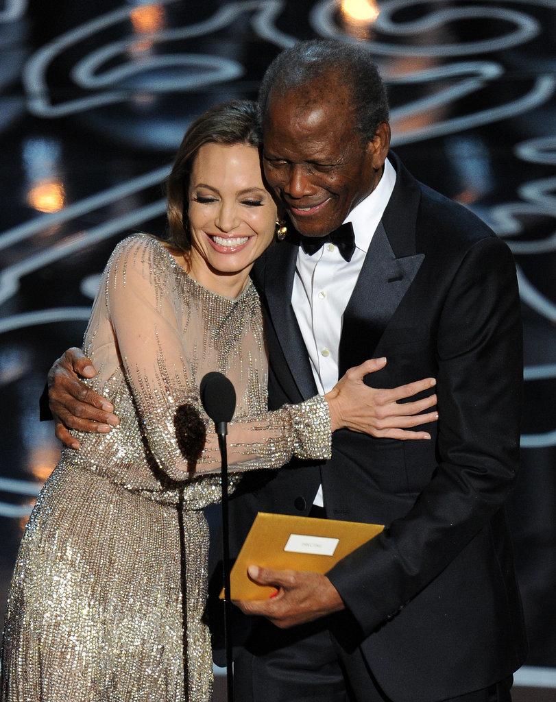 Angelina Jolie hugged Sidney Poitier.