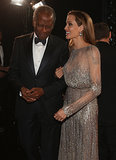 Angelina Jolie spoke with Sidney Poitier backstage at the Oscars.