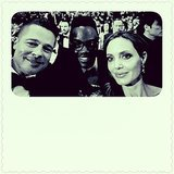 Brad Pitt and Angelina Jolie leaned in for a picture with Lupita's brother. Source: Instagram user nyongolaflame