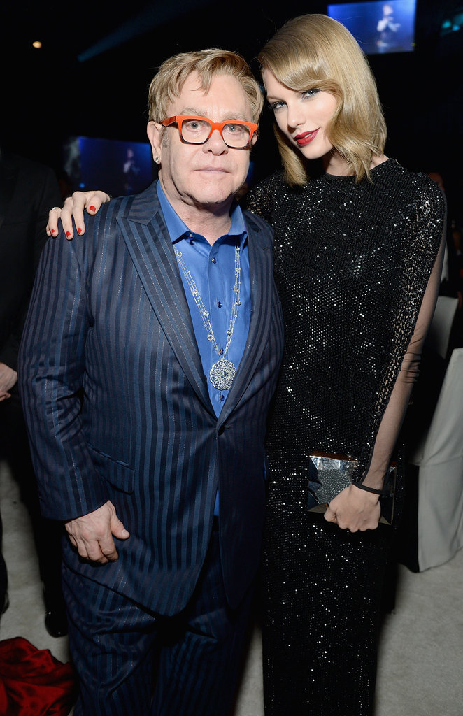 Elton hugged Taylor.