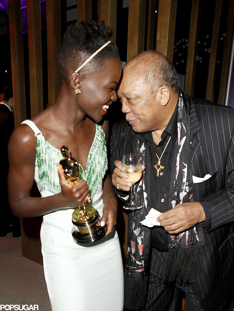 Lupita Nyong'o celebrated her Oscar win with music producer Quincy Jones.