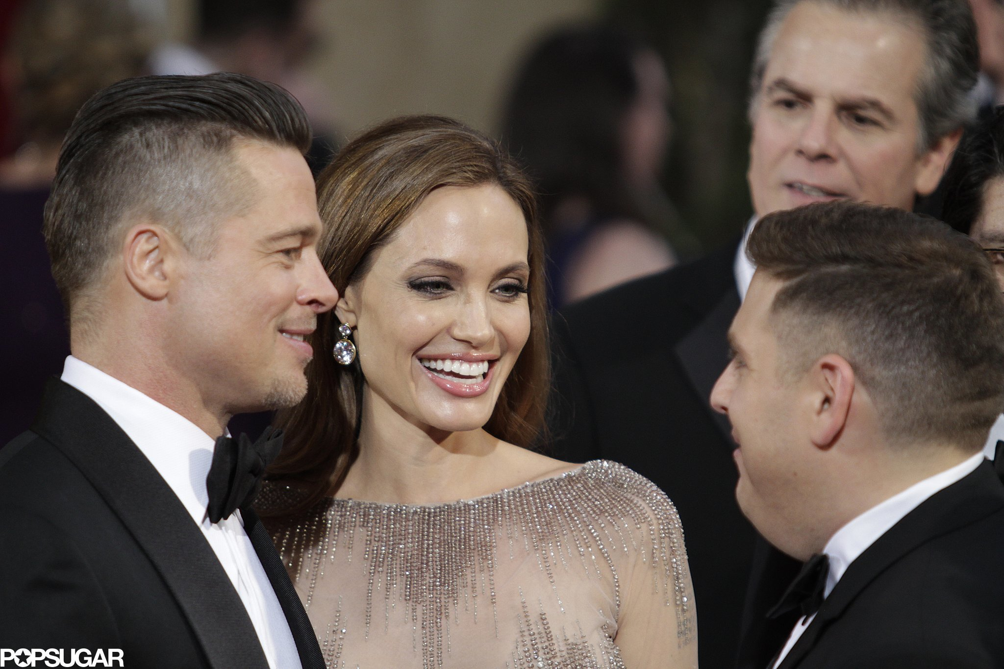 Brad Pitt and Angelina Jolie stopped to chat with Jonah Hill on the red carpet.