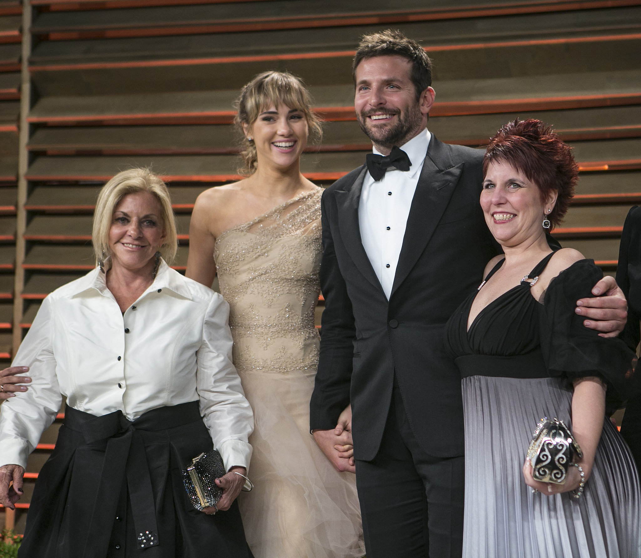 Bradley Cooper was surrounded by love at the Vanity Fair party with his mom, Gloria; his girlfriend, Suki Waterhouse; and his sister, Holly, by his