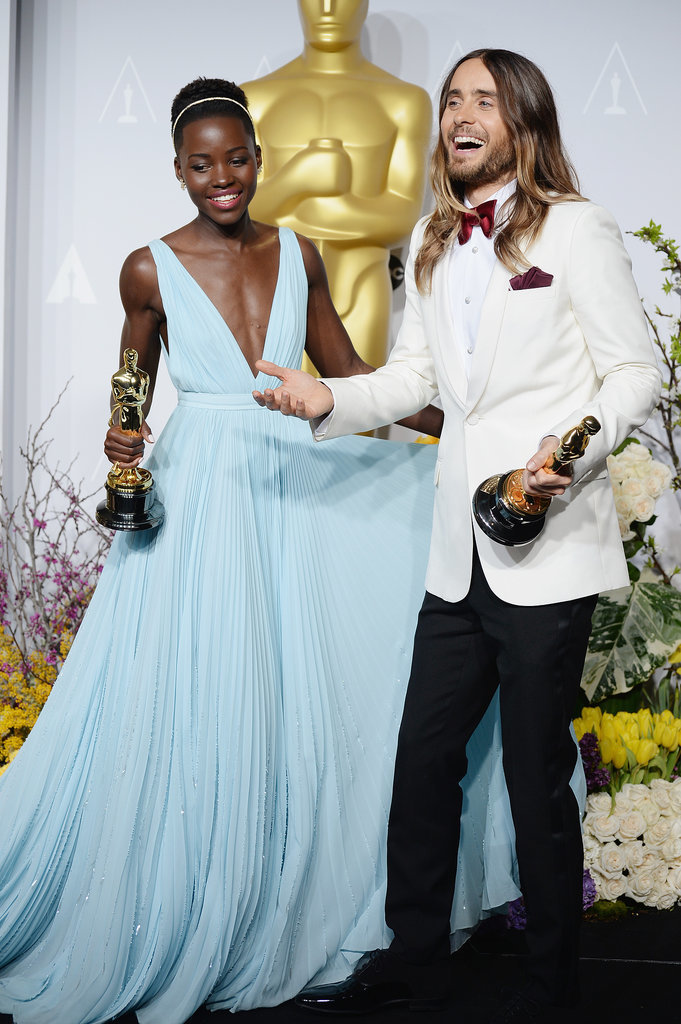 He and Lupita Nyong'o had a laugh while posing with their statues in the Oscars press room.