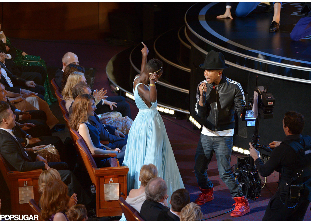 "Lupita Nyong'o didn't hold back during Pharrell's performance of ""Happy."""