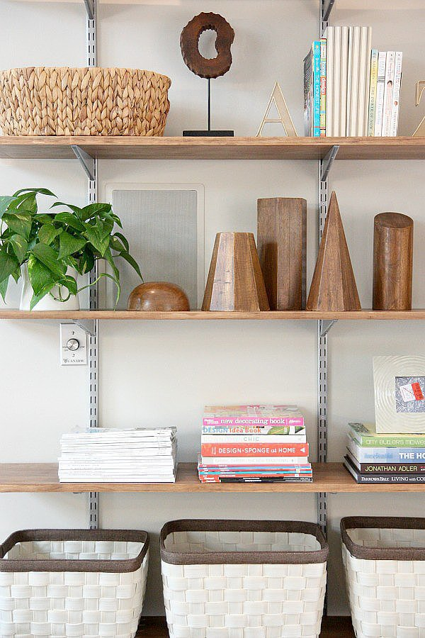 If you need additional storage, start with an off-the-shelf  bracket system that you can buy at any home-improvement store. Follow the rest of these DIY tips, and you'll have plenty of space for all your accents.  Source: Dana Miller for House*Tweaking