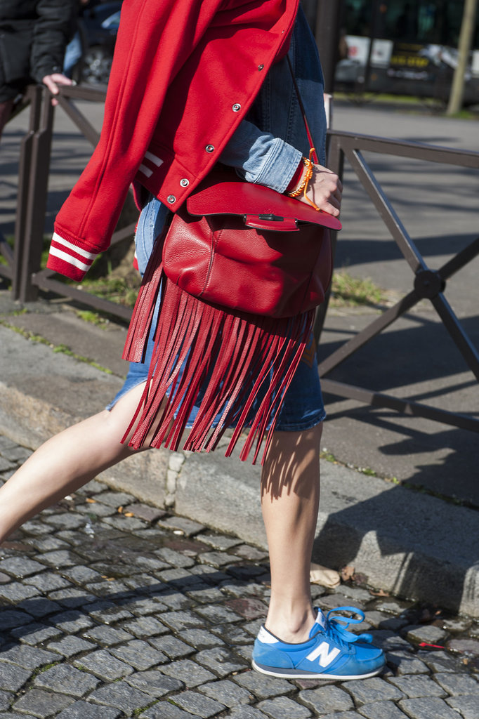 We can't resist her red accents — or that fringe.