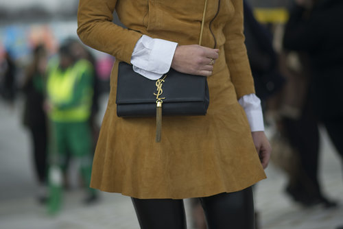 This black YSL bag and soft, camel suede team up for a perfectly polished look.