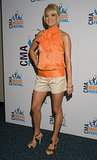 The vocalist wore jacquard shorts and a ruffled tangerine halter while doing press for the 2008 CMA Music Festival.