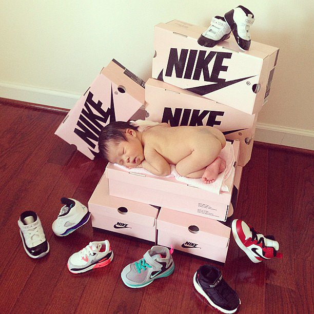 On a Stack of Nike Shoe Boxes