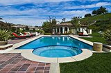 The highlight of the backyard is the large swimming pool and adjoining guesthouse.  Source: Trulia