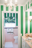 Now this is wallpaper done right. The green and pink combo results in an updated 50's vibe and one adorable bathroom.  Photo by  Kimberly Chau via Style Me Pretty