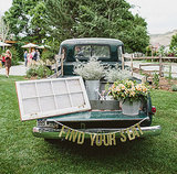"How cool is this? To greet guests at this reception, a green vintage truck was styled with a ""find your seat"" banner. Photo by EP Love  via Green Wedding Shoes"
