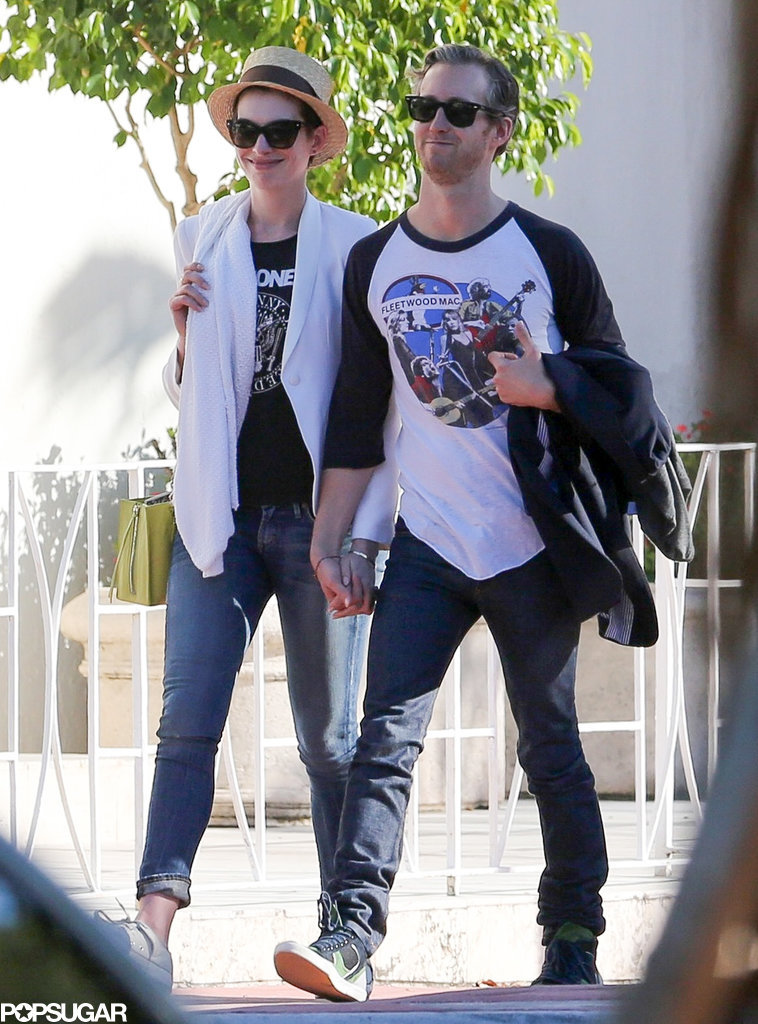 Anne Hathaway and Adam Shulman held hands while walking through Miami on Sunday.