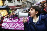 A woman shouted through a megaphone during a march in Istanbul on International Women's Day.