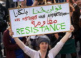 A woman held up a sign during a march in Paris.