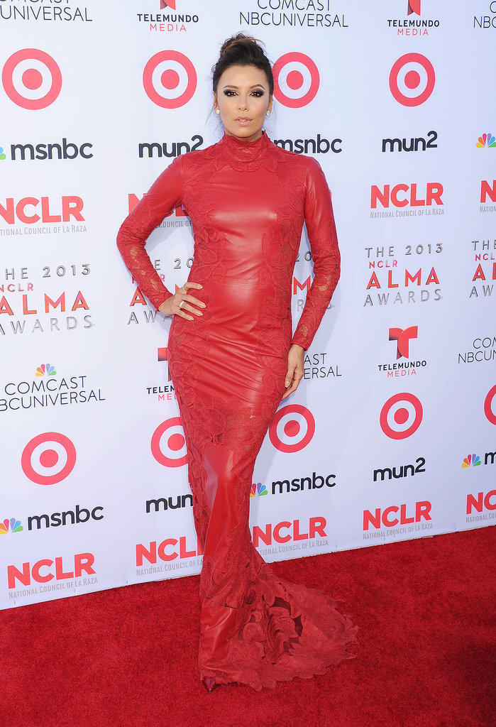 Before taking the stage as cohost of the 2013 ALMA Awards, Eva sizzled on the red carpet in a crimson Zuhair Murad gown featuring leather and lace embellishments. Can you say showstopper?