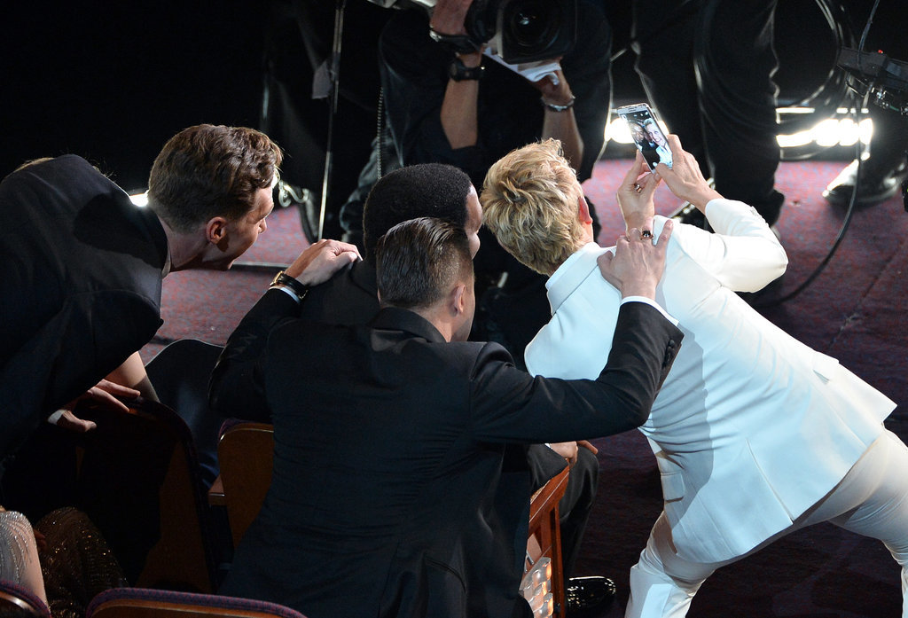 Ellen DeGeneres took a selfie with Brad Pitt and Chiwetel Ejiofar at the Oscars in March 2014.