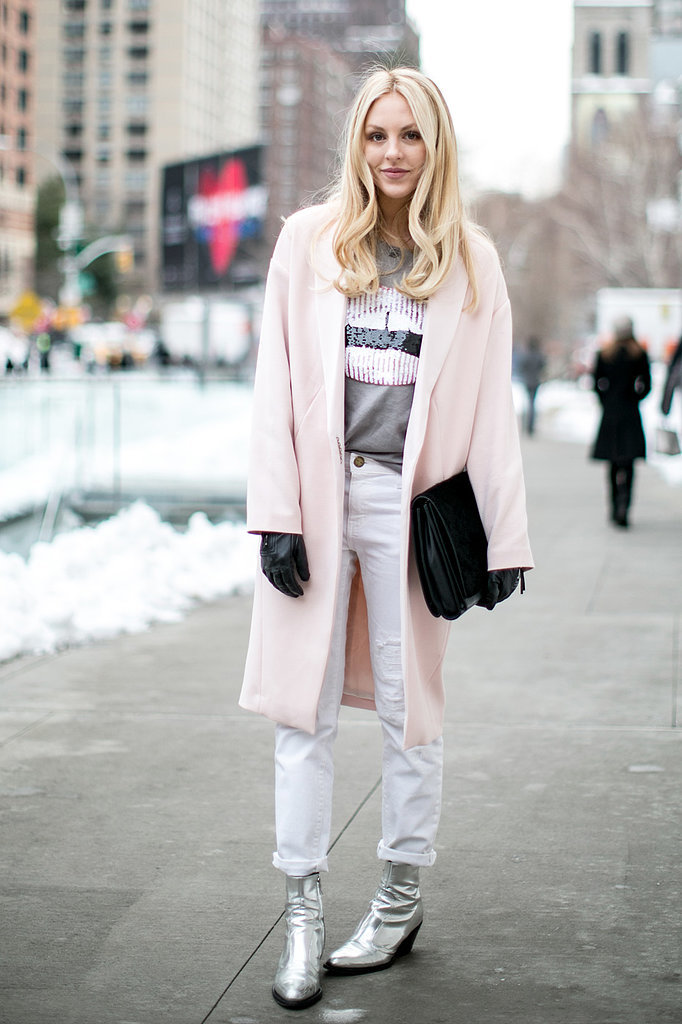 Silver boots, white pants and a pastel coat make for an icy-cool pairing at Fashion Week.