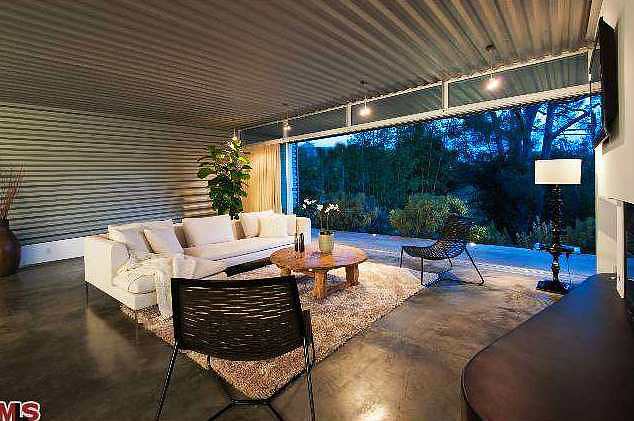 Whole walls of glass in every room allow for a seamless indoor-outdoor flow.  Source: Redfin