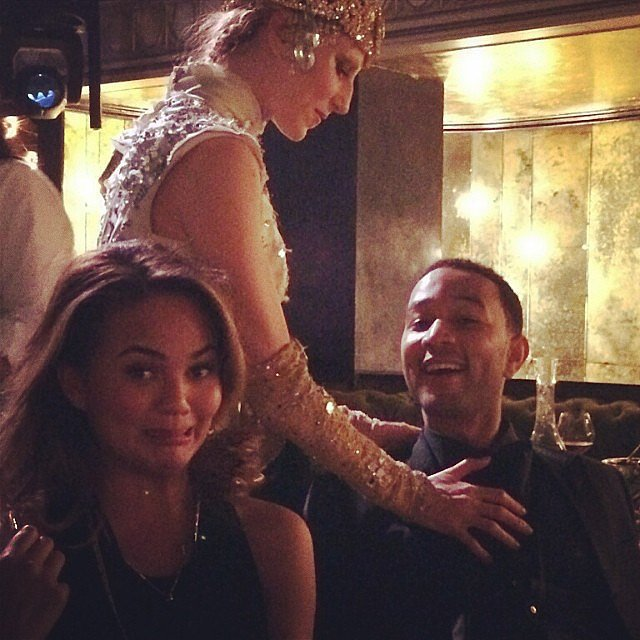 "Chrissy Teigen shared a snap of someone getting handsy with her husband, John Legend: ""aaaaah"