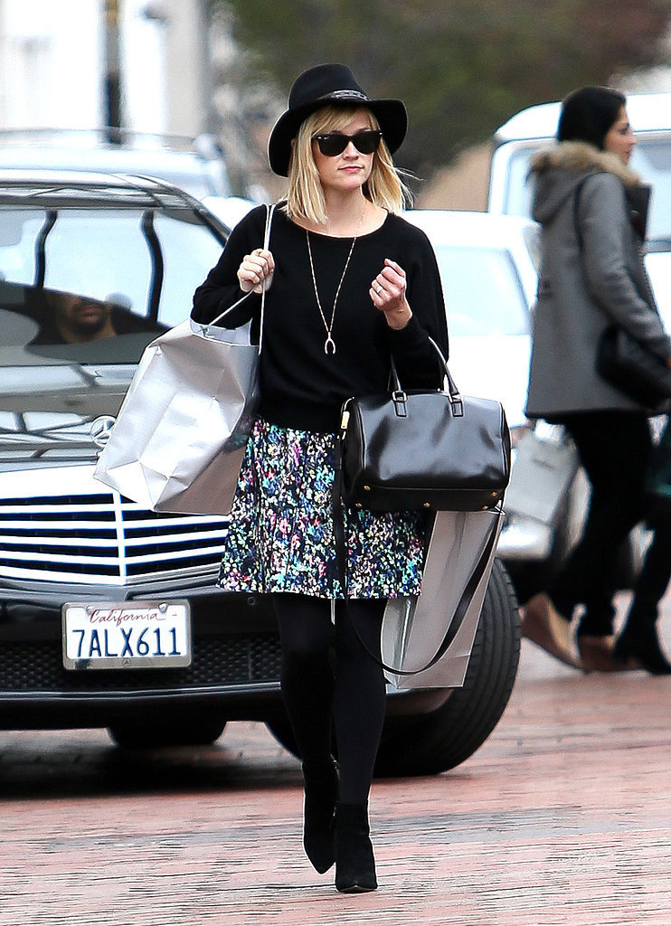 Reese Witherspoon in Floral Skirt and Black Hat