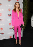 For anyone who was doubting the sex appeal of the tailored set, look no further than an expectant Stacy Keibler! She made the look superfeminine by picking a bold pink color — and wearing no shirt underneath.