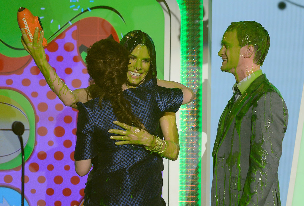 Kristen Stewart hugged a slimed Sandra Bullock alongside Neil Patrick Harris in 2013.