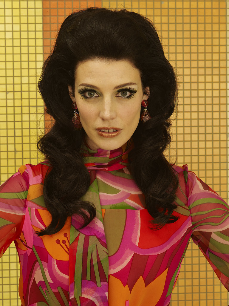 Jessica Paré as Megan Draper.