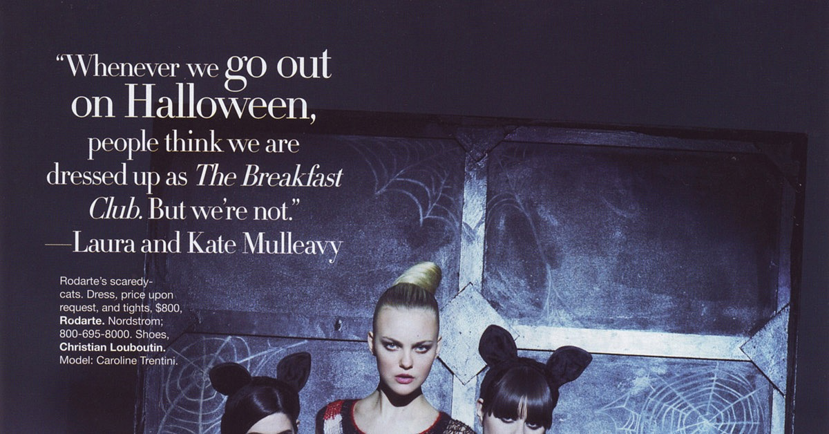 Laura and Kate Mulleavy as black cats on Halloween with Caroline Trentini.
