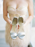 8. Bride Holding Shoes