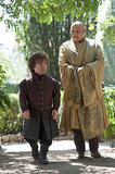 Tyrion walks with Varys.