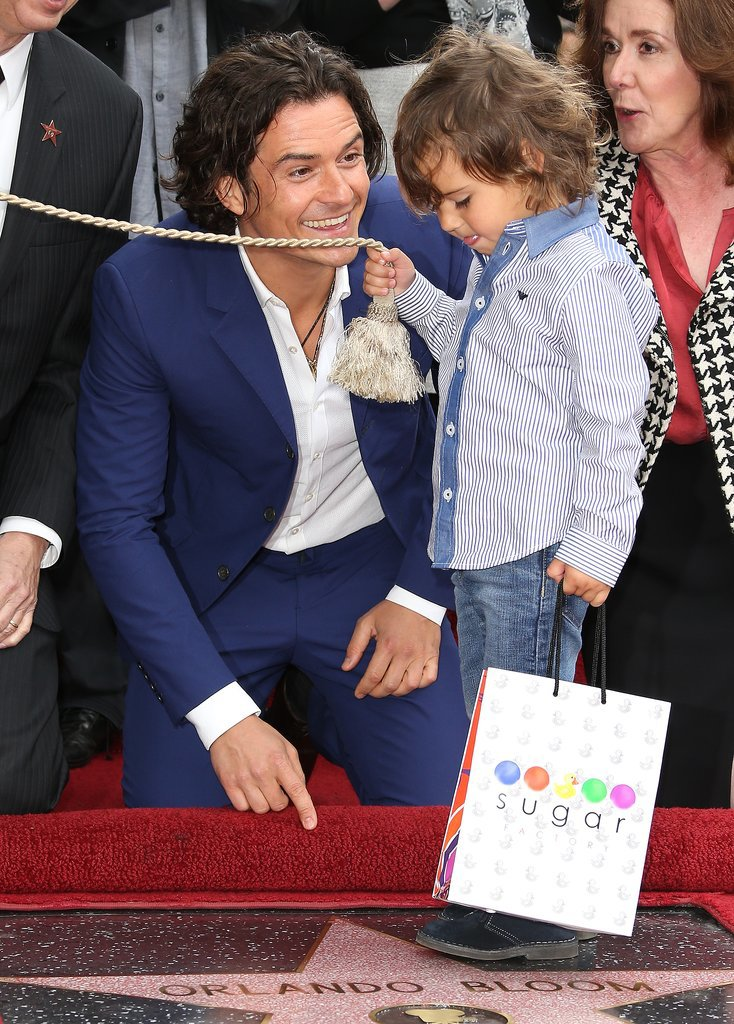 Orlando Bloom lit up next to his 3-year-old son, Flynn, at the actor's Hollywood Walk of Fame ceremony in LA.