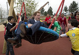 Prince Harry let loose while playing with children during a visit to the Queen Elizabeth Olympic Park in London.
