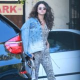 Selena Gomez Black-and-White Jumpsuit and White Coach Bag