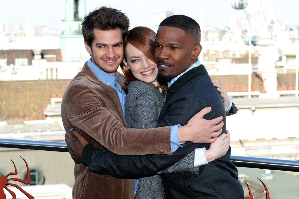 Andrew Garfield and Jamie Foxx gave Emma Stone a hug while promoting The Amazing Spider-Man 2 in London.