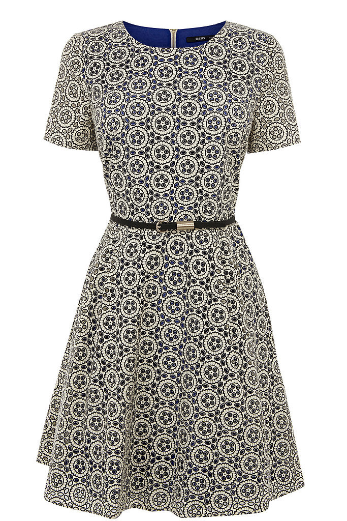 Shop the exact same sweet fit-and-flare Oasis dress ($97). The floral detailing makes it adorably feminine, and the belt at the waist only helps define your shape — plus, how Taylor is this look? This makes channeling the star's style effortless.