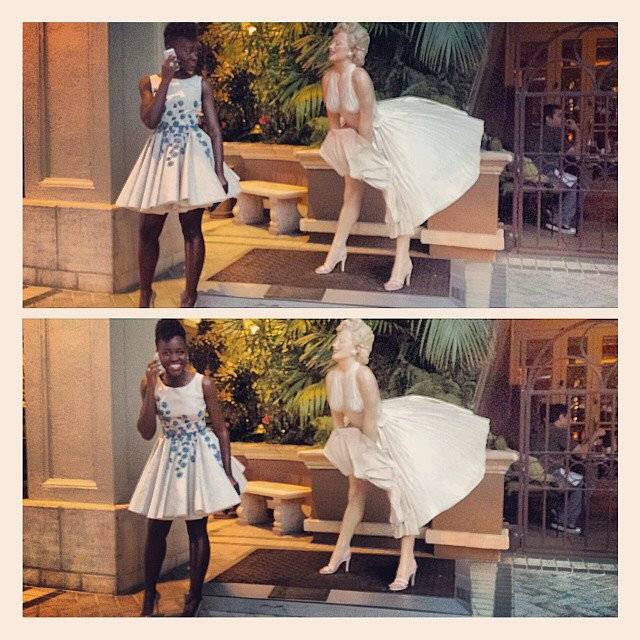 Lupita Nyong'o ogled a Marilyn Monroe statue adorably. Source: Instagram user lupitanyongo