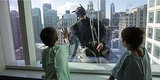 Superhero Window Washers Swoop In To Brighten Up Kids' Day At Lurie Children's Hospital