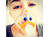 Miley Cyrus Wears Duck-Face Oxygen Mask, Postpones U.S. Bangerz Tour