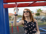 Emma Stone helped spray-paint some monkey bars.