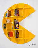 "This ""Puckman"" bookcase (price upon request) is made to order and comes available in yellow, white, and black. So hard to choose!"