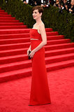 Anne Hathaway's red gown matched the carpet's bright hue.