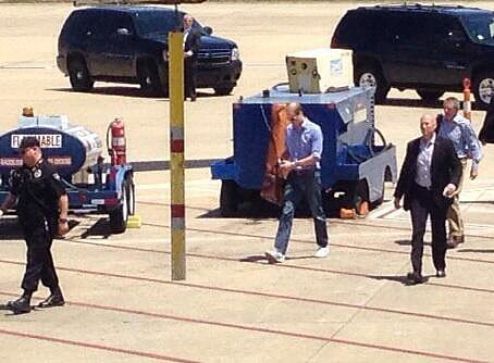 William boarded his commercial flight with a group of security guards. Source: Twitter user local24eli