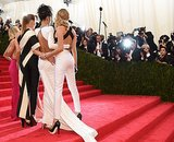 Reese Witherspoon, Stella McCartney, Rihanna, and Cara Delevingne grouped together on their way up the stairs.