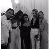 She scored a photo with Givenchy designer Riccardo Tisci, Cara Delevingne, Kate Bosworth, and supermodel Naomi Campbell, who literally LOL'ed at Kim's Vogue cover last month. Source: Instagram user kimkardashian